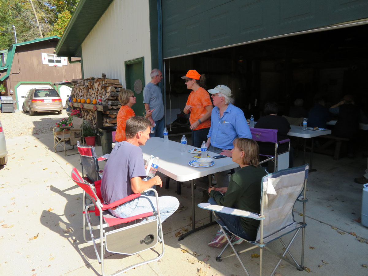 Group eating lunch outdoors after tracking test